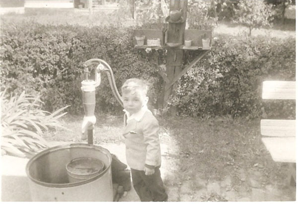 Jeffrey Wiles with hand water pump