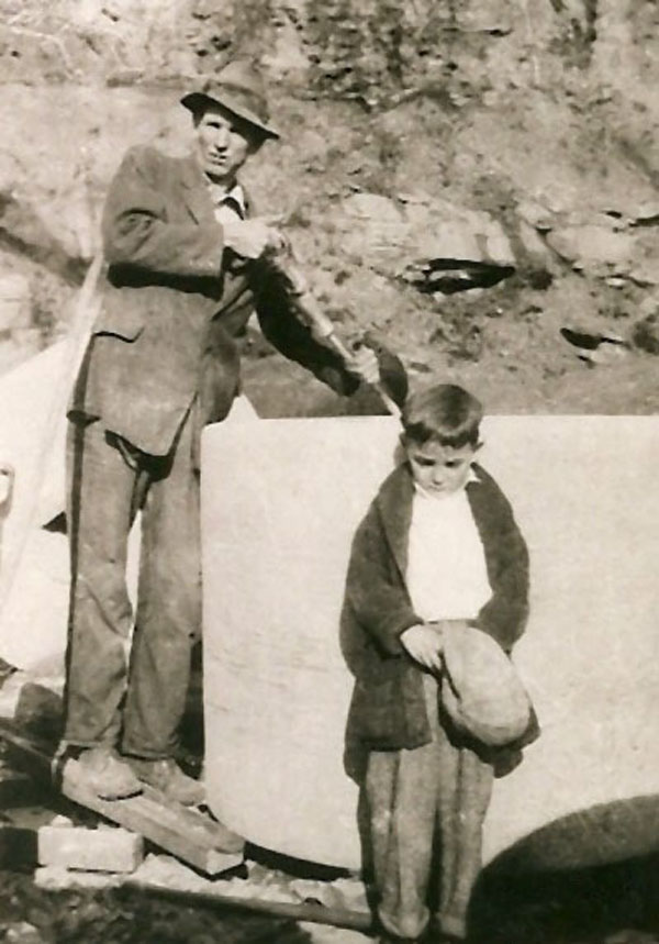 Wesley and Russell Wiles with millstone