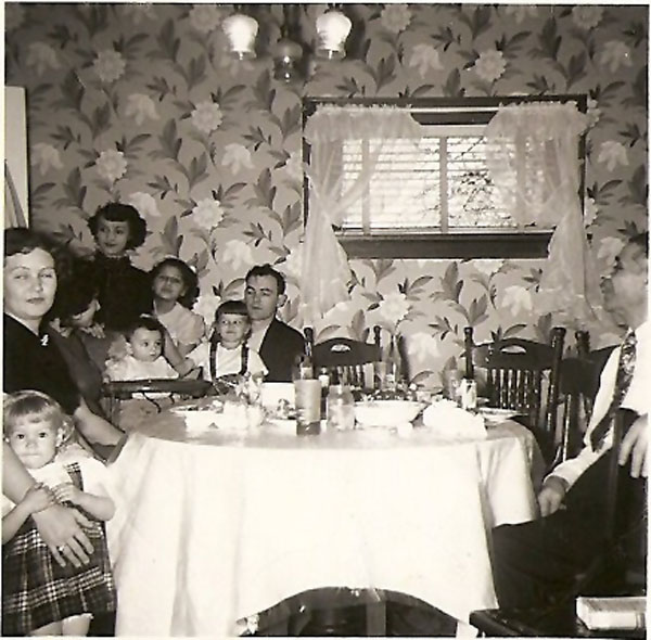 (at table) Unknown Child and Woman, Anita and Jeffrey Wiles, Unknown Child, Russell Wiles and Nick Common, (standing rear) Netta Common? and Kathi Common