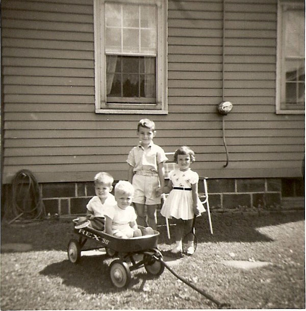 (in wagon) Steve and Jimmy Common, (standing) Jeffrey Wiles and Karen Sue Common