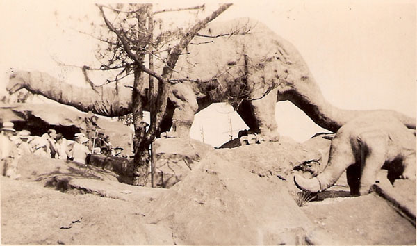Brontosaurus, unknown people, back of Triceritops
